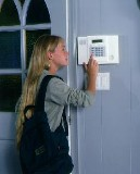 Girl setting Alarm - Security Systems in Cranston, RI